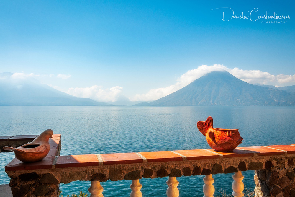 Amusing ceramic figures on a terrace overlooking lake Atitlan