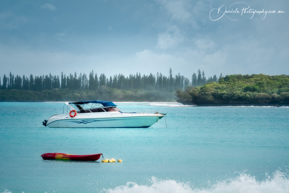 Boats on the water at Kuto Bay on Isle of Pines in New Caledonia