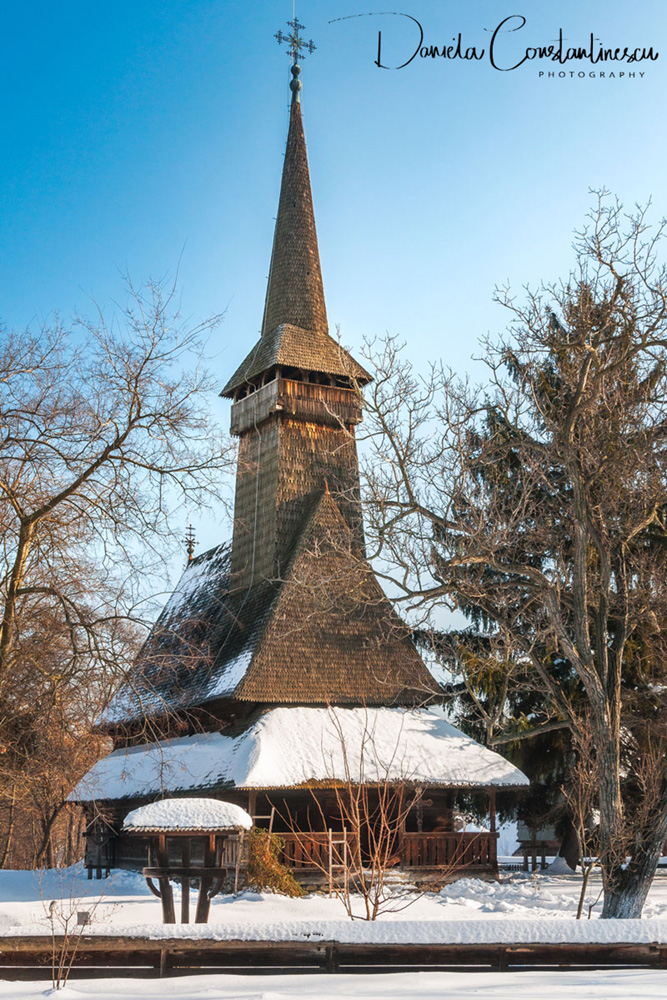 Traditional Romanian wooden Church covered in snow